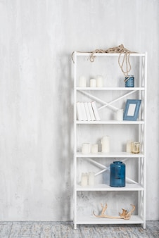 Stylish bookshelf with decorations