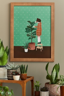 木製のモックアップポスターフレームを備えたホームガーデンインテリアのスタイリッシュな植物学の構成は、さまざまなデザインの鉢や花のアクセサリーでたくさんの美しい観葉植物、サボテン、多肉植物を満たしました。テンプレート