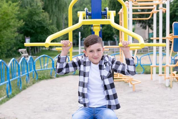 Stylish boy in plaid shirt