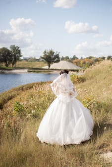 Stylish bride at the field