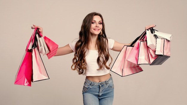Stylish brunette woman with loads of shopping bags