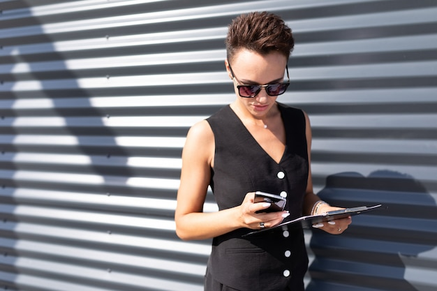 Stylish business woman on the surface of an office fashionable building