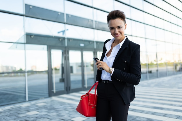 Stylish business woman at work, concept of a strong and confident woman