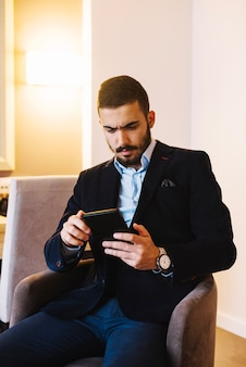 Stylish businessman with tablet