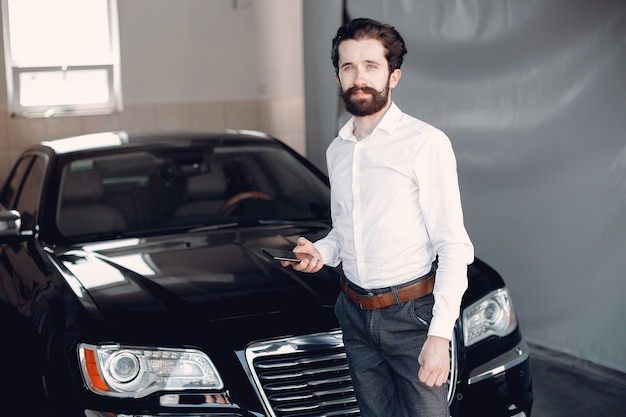 Stylish businessman working near the car
