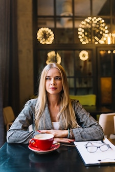 Stylish businesswoman with laptop in cosy coffee shop