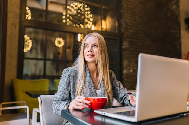 Stylish businesswoman with laptop at desk