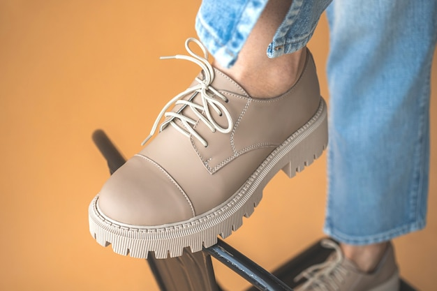 Stylish casual shoes, modern sneakers with white laces close-up. fashionable teen girl clothes style photo