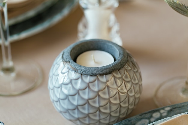 Stylish ceramic round candle stand close up