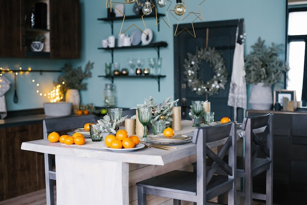 Stylish christmas table with tangerines for new year celebrations