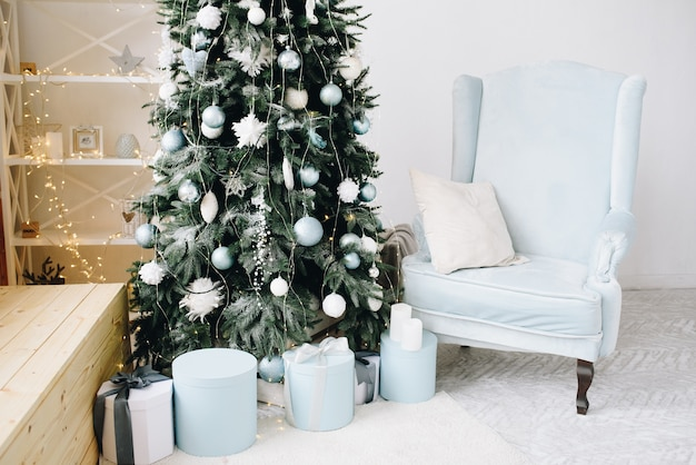 Stylish christmas tree surrounded by wrapped presents