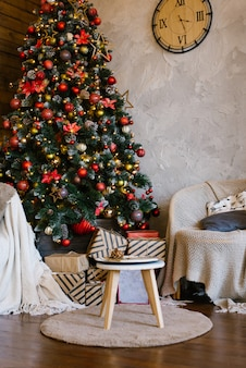 Stylish classic interior of a country house with a christmas tree