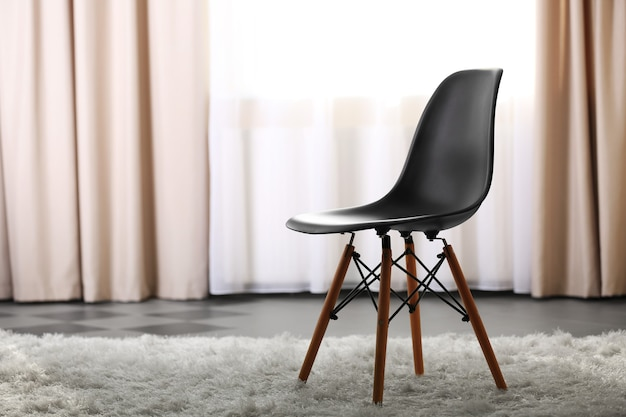 Stylish conception with black chair on light room