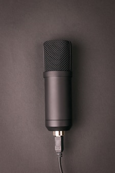 Stylish condenser microphone on a dark background. sound recording equipment.