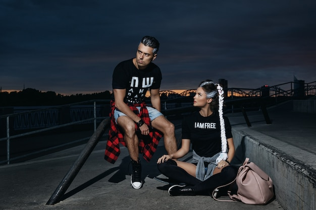 Stylish couple in the skate park