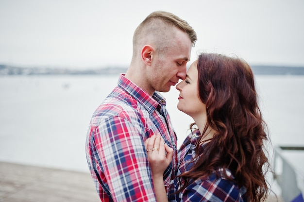 Stylish couple wear on checkered shirt in love together