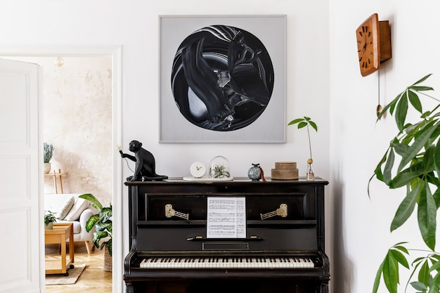 Stylish and cozy interior of living room with black piano, furniture, plant, wooden clock, lamp, painitngs, carpet, decoration and elegant personal accessories in modern home decor.
