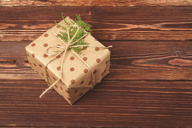 Stylish decorated christmas gifts over brown wooden
