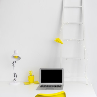 Stylish desktop in white color with yellow details