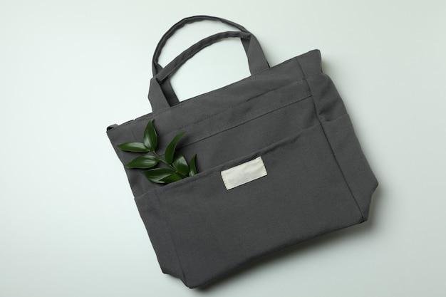 Stylish eco bag with twig on white