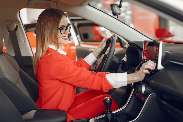 Stylish and elegant woman in a car salon