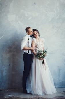 Stylish european couple hugging