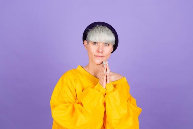Stylish european woman on purple wall