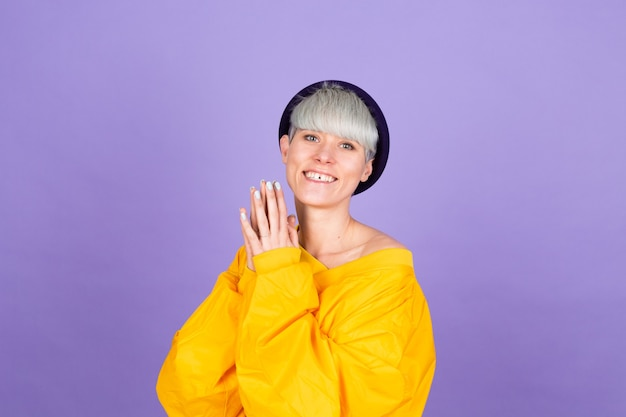 Stylish european woman on purple wall