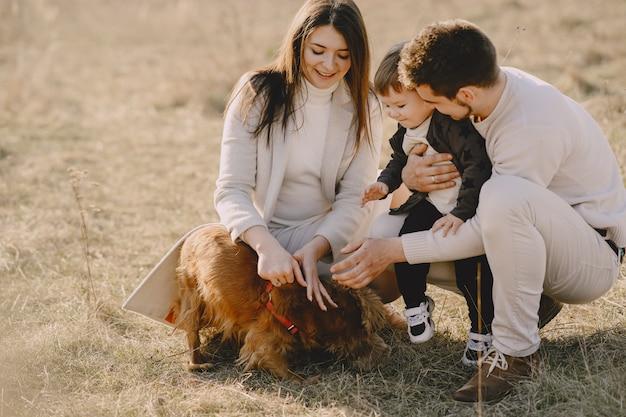 Stylish family walking on a sunny field