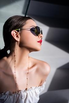 Stylish fashion woman in sunglasses, trendy fashionable accessories.