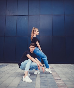 Stylish and fashionable couple posing in city
