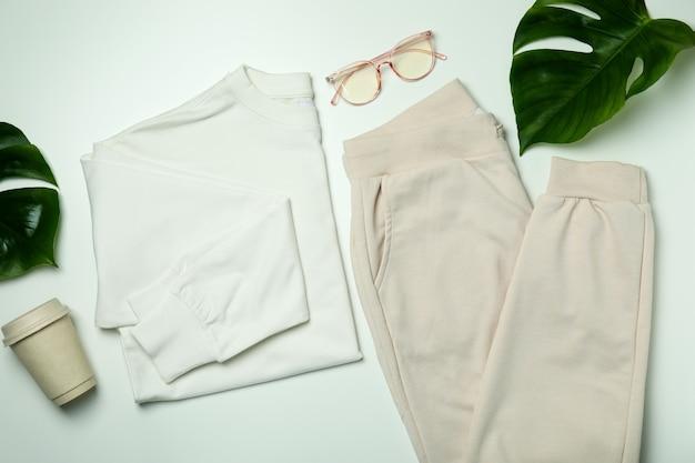 Стильная женская одежда на белом фоне