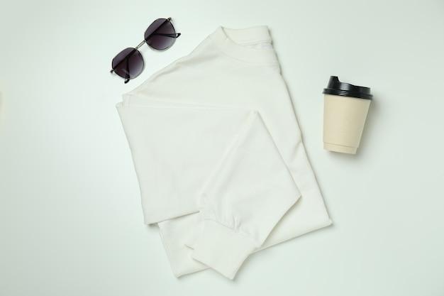 Стильная женская одежда на белом, вид сверху