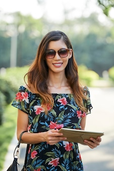 Stylish female with tablet