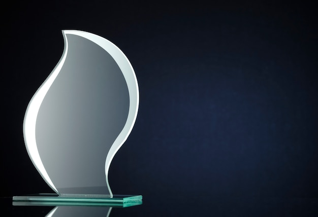 Stylish flame shaped glass trophy with copyspace