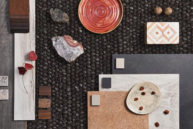 Стильная плоская композиция архитектурного мудборда с образцами строительного материала, коричневым текстилем и натуральными материалами, а также личными аксессуарами. вид сверху, шаблон.