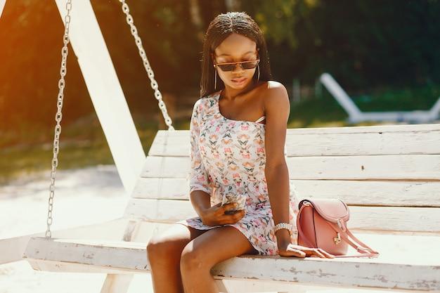 Stylish girl sitting on a swing