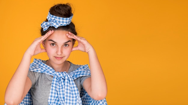 Stylish girl thinking with copy space