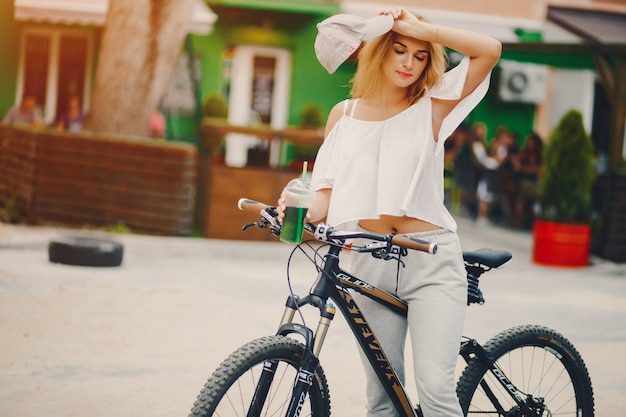 Stylish girl with bicycle
