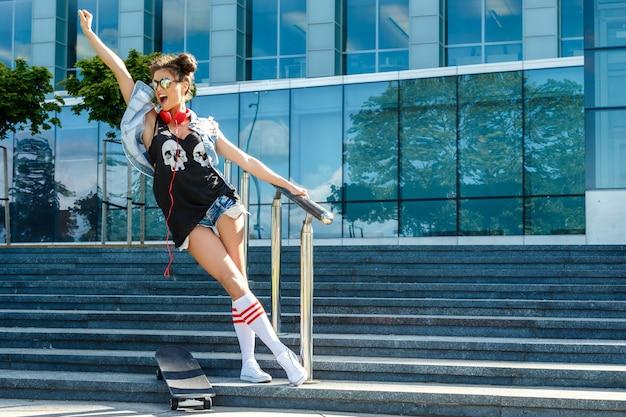 Stylish girl with a skateboard