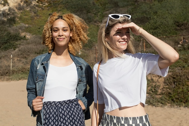 Stylish girls hanging out at the beach outdoor photoshoot