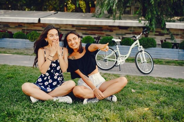 Stylish girls walking in a summer park