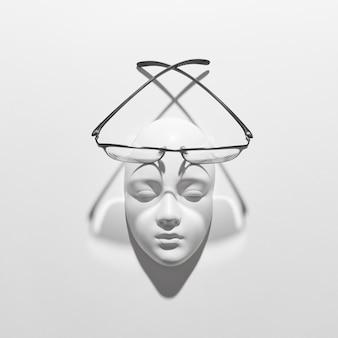 Стильные очки в черной оправе или повседневное чтение на гипсовой скульптуре лица на белой стене, мягкие длинные тени, место для текста. плоская планировка