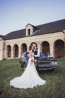 Stylish groom kisses the bride
