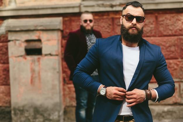 Stylish guy buttoning his jacket