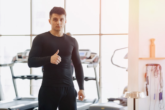 Stylish guy in the gym posing for a photo