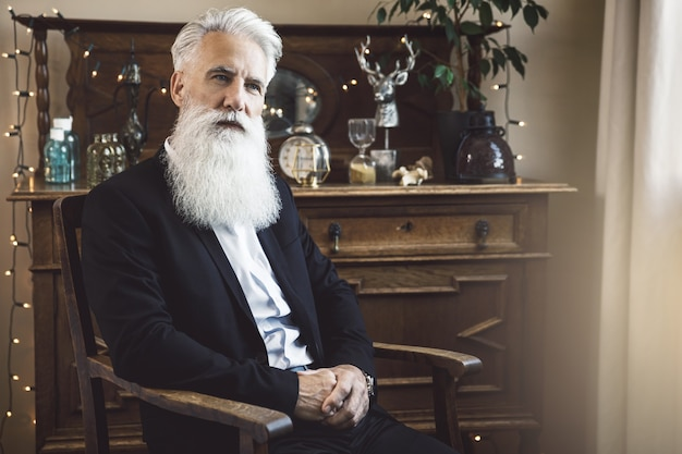 Stylish and handsome bearded senior man posing in studio