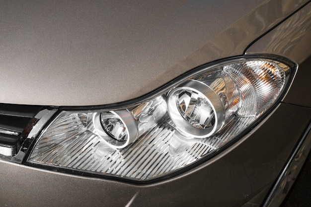 Stylish headlight of dark grey automobile