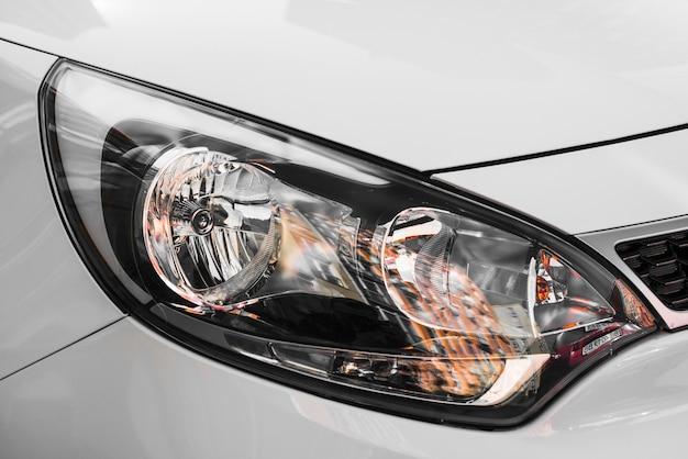 Stylish headlight of grey automobile
