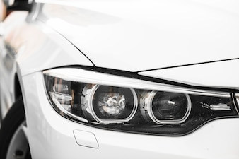 Stylish headlight of white car